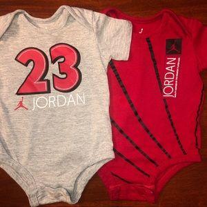 Never worn. Two Jordan Onesies 3-6 Months